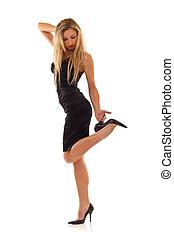 blond posing in little black dress