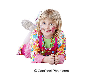 Young blond pretty girl in Carneval disguise lies on the floor and laughs
