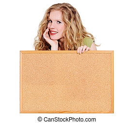 Young blond smiling woman holding a cork board isolated on white