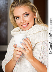 Young blond with hot beverage. - Portrait of winter fashion...