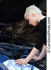 Young Blond Woman and Broken Car