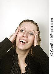 Young blond woman having headache