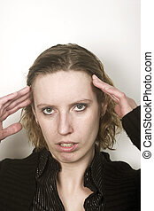 Young blond woman having headache with pain on her face