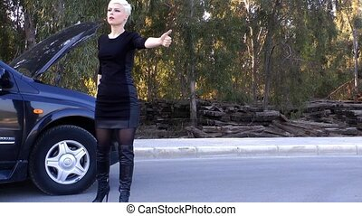 Young Blond Woman Hitchhiking on Road near Car