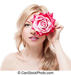 young blond woman holding flower