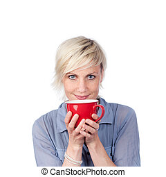 Young Blond Woman Holding Red Coffee Cup