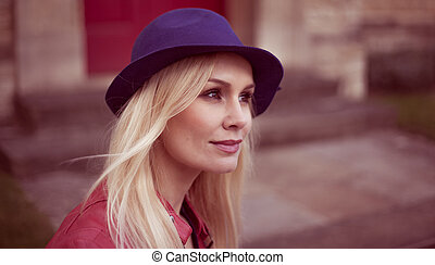 Young blond woman in a trendy hat