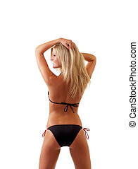 Young blond woman in black bikini from back