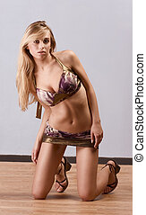 Young blond woman in bra and shirt skimpy skirt