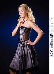Young blond woman in dress