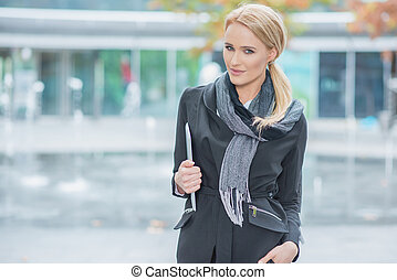 Blond Woman in Fashionable Black Office Attire - Young Blond...