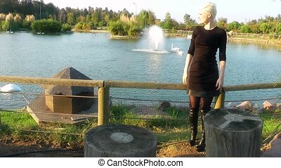 Young Blond Woman in Natural Park