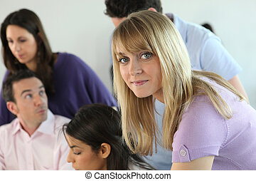 Young blond woman in studygroup