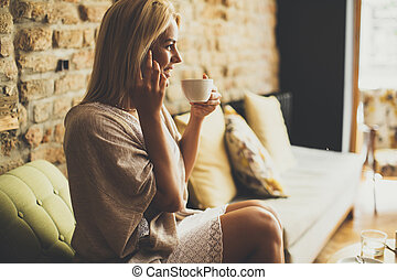 Young blond woman in the cafe