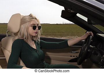 young blond woman in the car