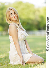 Young blond woman in the field