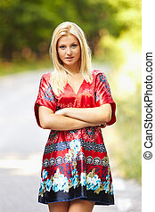 Young blond woman outdoor