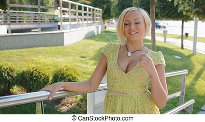 Young blond woman pose photographer outdoor