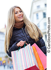Young blond woman shopper
