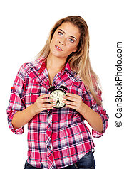 Young blond woman showing alarm clock