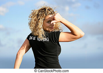 Young blond woman showing her t-shirt