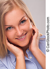 Young blond woman smiling