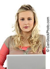 Young blond woman using laptop computer