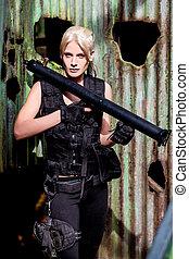 Young blond woman wearing a Bazooka