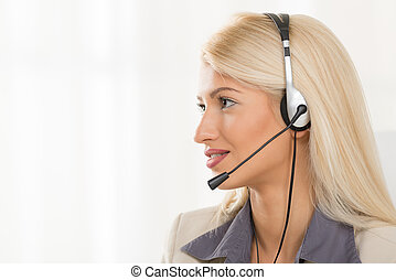 Young Blond Woman With A Headset