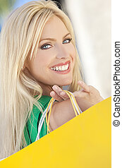 Young Blond Woman With Blue Eyes and Shopping Bags - Natural...