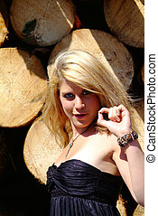 young blond women - blond women with a black dress in the...