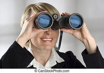 binocular - young blond women looking through binocular -...