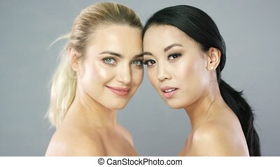 Young blonde and brunette model in studio - Pretty young...