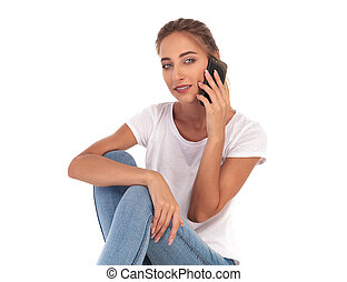 young blonde casual woman talking on the phone