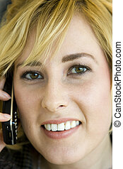 Young Blonde Caucasian Woman on Mobile Phone