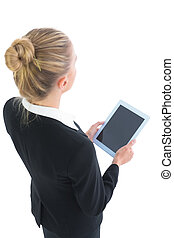 Young blonde cute businesswoman holding her tablet