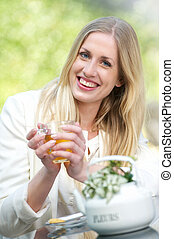 Young Blonde Girl Drinking Tea