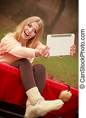 Young blonde girl in park.