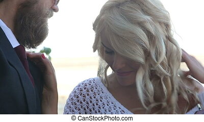 young blonde girl looks into bearded guitarist eyes