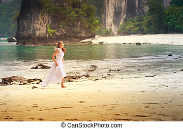 young blonde girl run barefoot on sand   beach