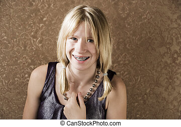 Young blonde girl with braces - Blonde teenager with braces ...