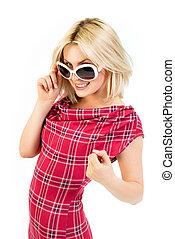 Young blonde in tartan dress