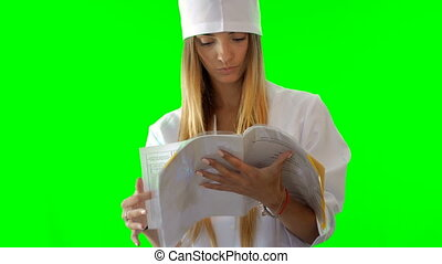 young blonde nurse thumbs a nobebook in uniform