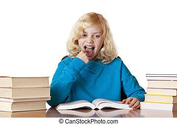 Young blonde pretty schoolgirl is upset because of homework.