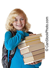 Young blonde Schoolgirl with schoolbag holds a pile of books and smiles.