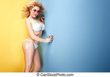 Young blonde sexy woman in bikini.