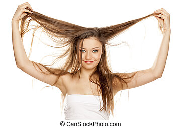 young blonde showing her long straight hair
