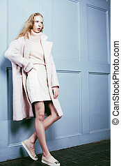 young blonde teenage girl in fur coat, fashion dressed model, st
