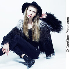 young blonde teenage girl in hat and fur coat, fashion dressed model, studio shot