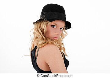 Young blonde teenager girl in studio